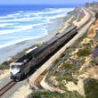 The Pacific Surfliner travels along the coastline in Del Mar, California. The Pacific Surfliner offers a unique vantage on the Southern California seascape connecting San Luis Obispo and San Diego through Los Angeles and Santa Barbara.