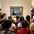 May 25, 2018: Crowd of people surround the Starry Night painting by Vincent van Gogh inside the Museum of Modern Art.