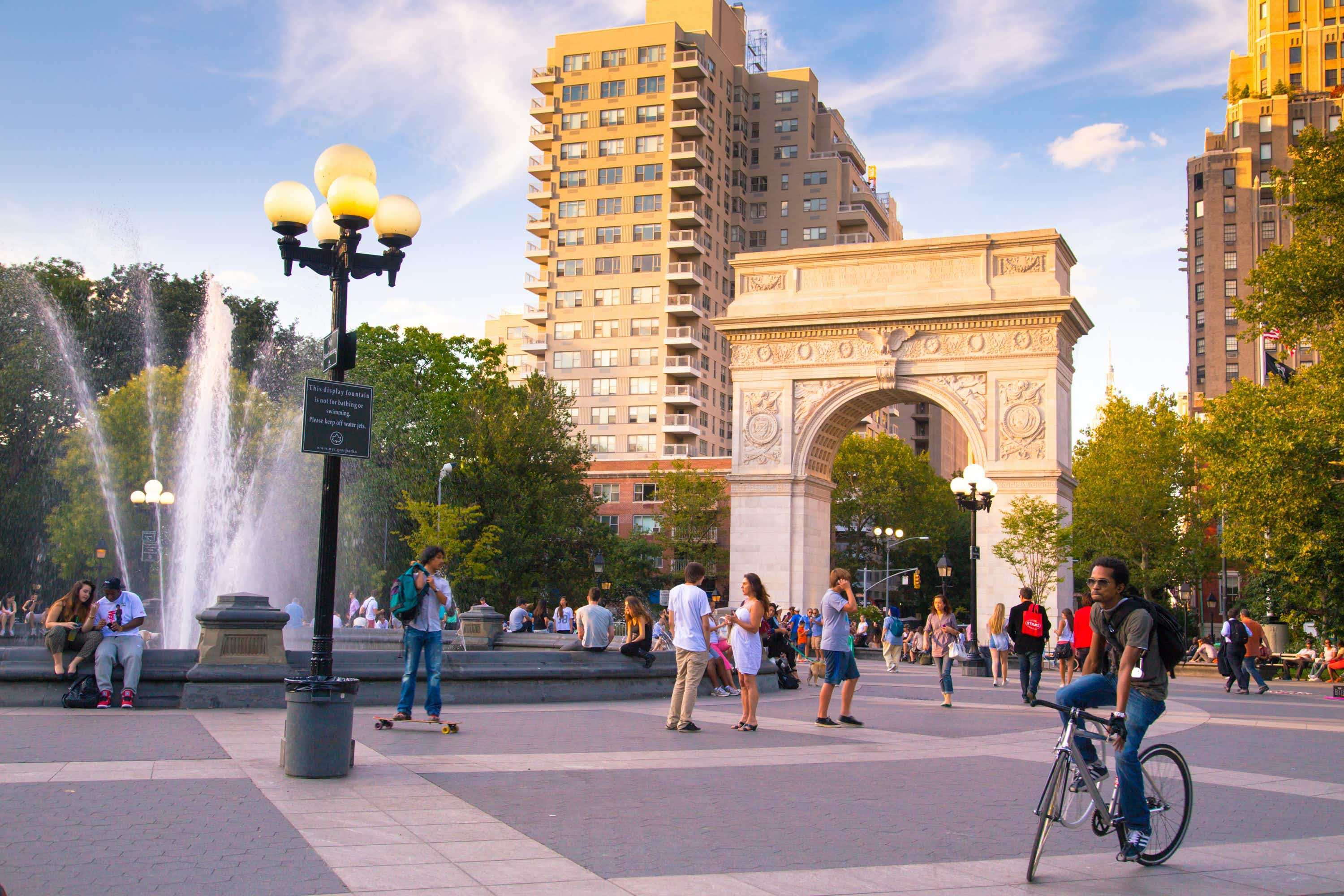 NEW YORK CITY - AUG 15:  Summer evening at Washington Square Park in Manhattan on Aug 15, 2013.  Washington Square Park is a 9.75 acre park located in Greenwich Village and is a popular meeting spot.