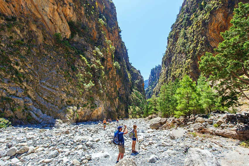MAY 26, 2016: Tourists hike through Samaria Gorge in central Crete.