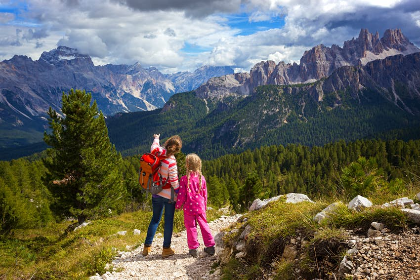 two sisters girls hikers at the mountains Dolomites, Italy. Cinque Torri