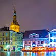 AUGUST 16, 2016: brightly lit restaurants surrounding the town hall square in the old town of Tallin at night.