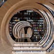 Visitors travel through a tunnel of book © X+Living