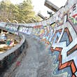 A picture taken on February 5, 2014 shows Sarajevo's abandoned  Sarajevo's bob sleigh track near Sarajevo. Built and used as an Olympic venue during Sarajevo's 1984 Winter Olympic Games, the track was heavily damaged during Bosnia's 1992-95 war. It was ne