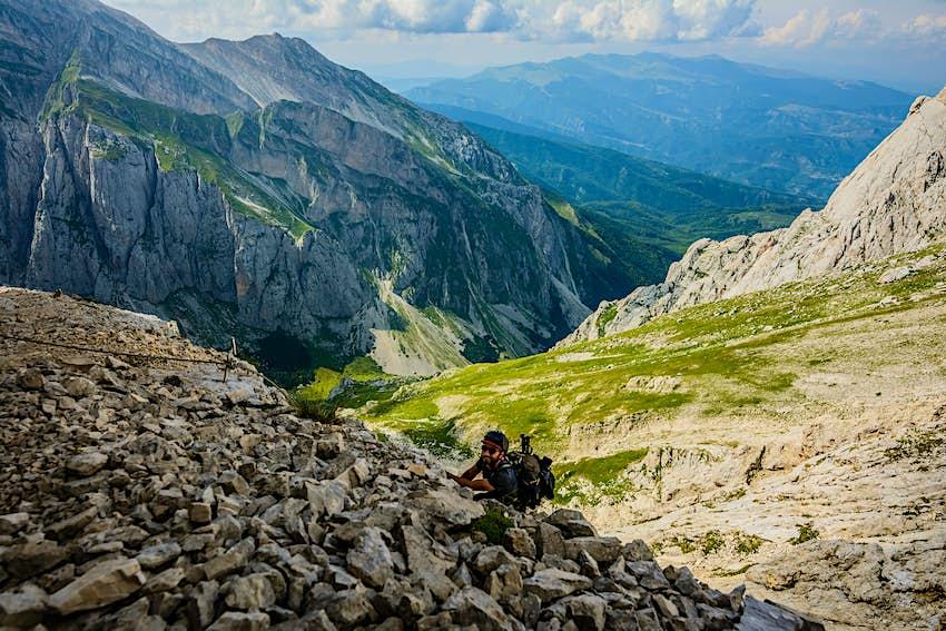 A male climber on a Via Ferrata of the Corno Grande, the main peak of the Gran Sasso massif in Abruzzo.