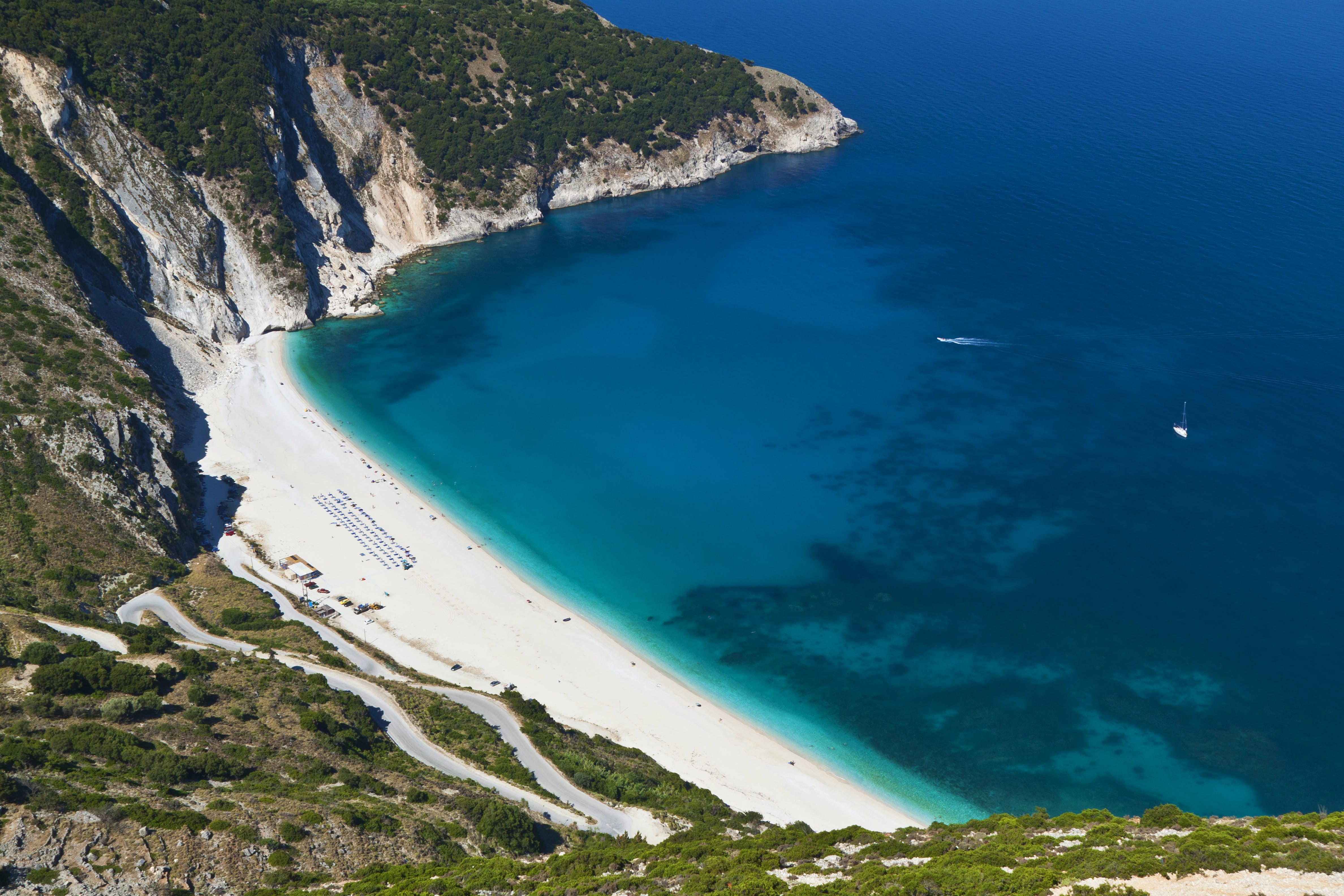 Aerial view of Myrtos Beach with white sand and light blue waters in Kefallonia, Greece