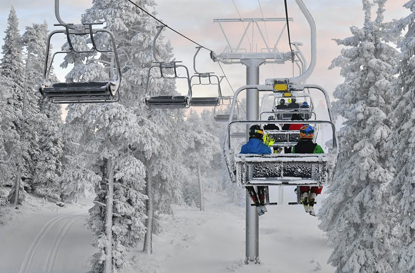 Ski chair lift with skiers