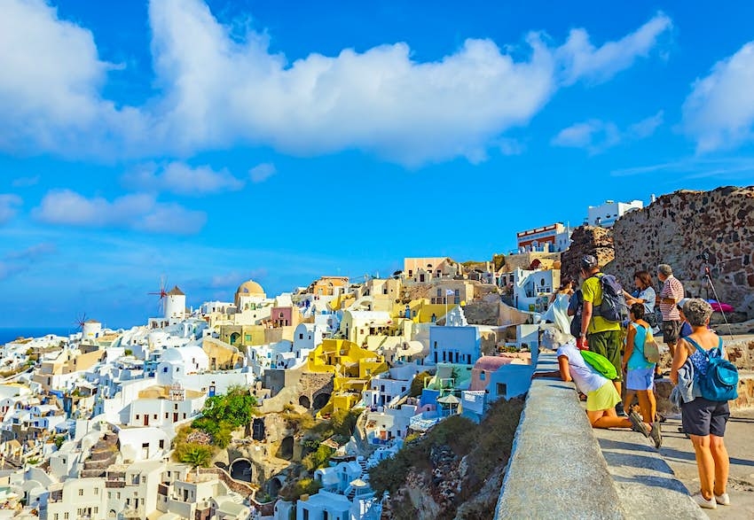 Tourists visiting Oia town on Santorini on a sunny day