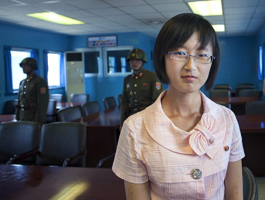 Woman visiting DMZ Joint Security Area between North and South Korea
