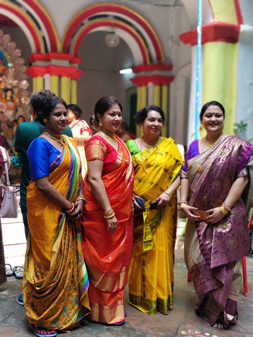 Ladies of the house dress in their festive finery every day of the pujo..JPG
