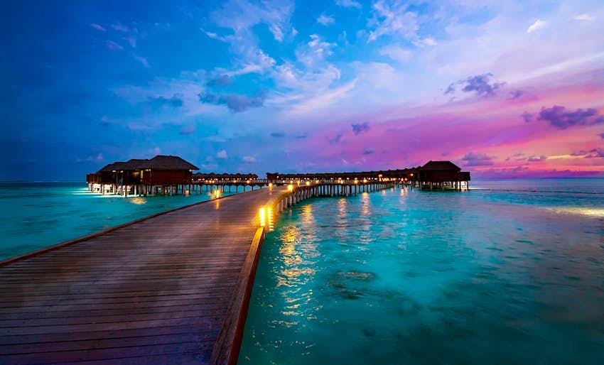 Oversea resort huts at end of long jetty, Maldives