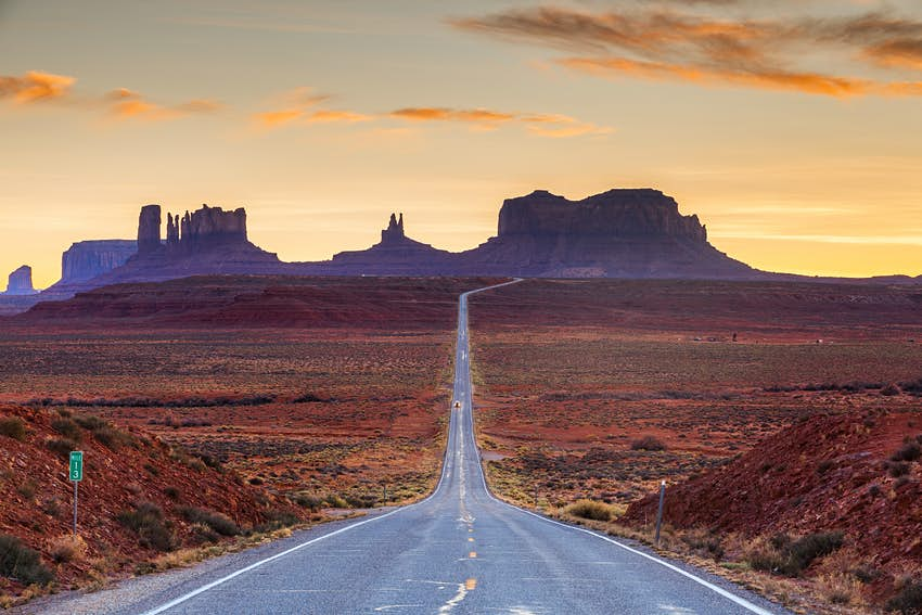 A road leading to the tall plateaus of Monument Valley