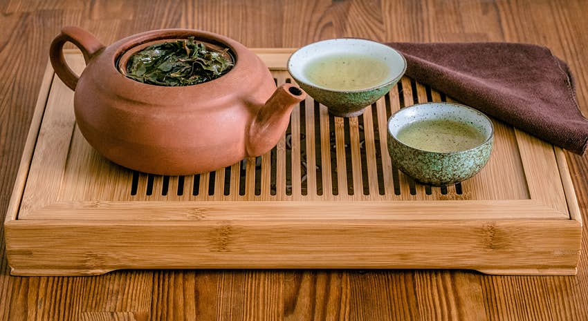 Chinese Gongfu tea ceremony with Oolong tea on chaban table