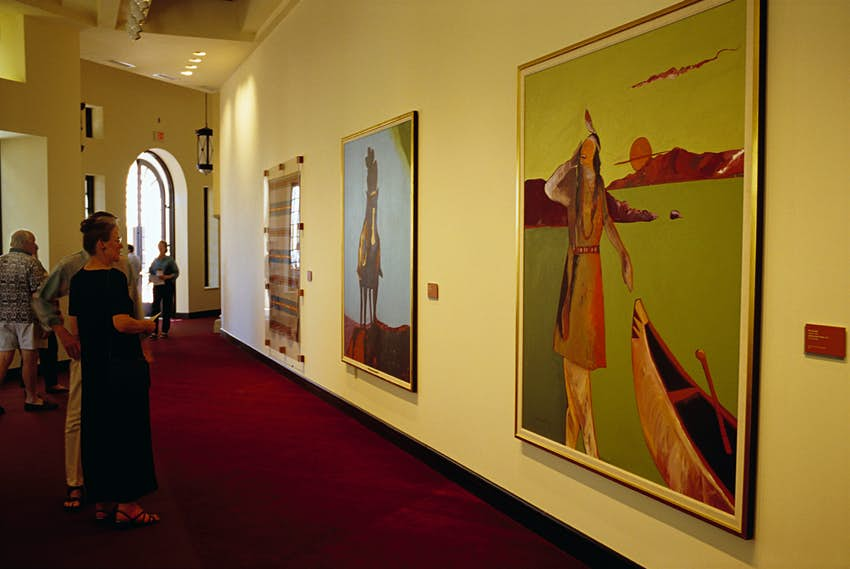 Visitors at the Heard Museum View Paintings by Fritz Scholder