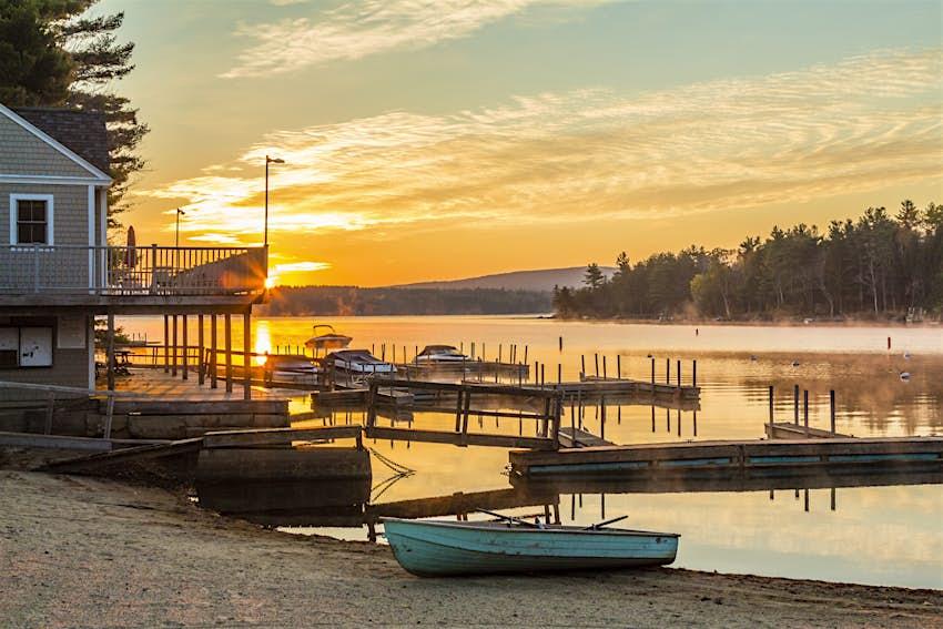 Boats on the shore at sunset at Lake Sunapee, New Hampshire