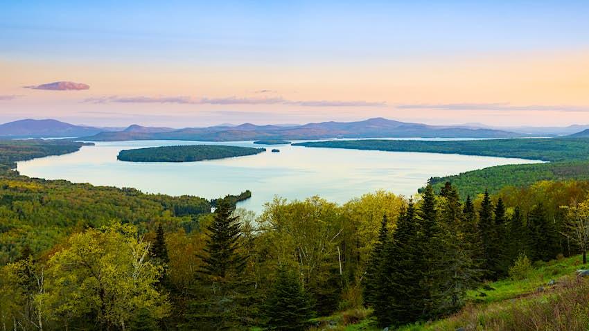 Colorful sunset sky behind Mooselookmeguntic Lake, Maine