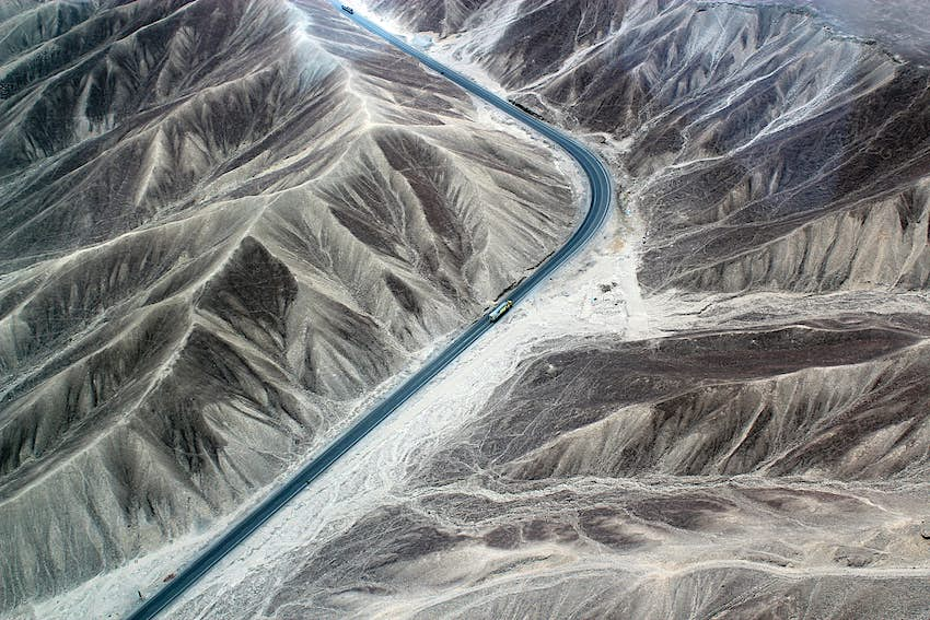 Aerial of the Pan-American highway and the Nazca desert in Peru.