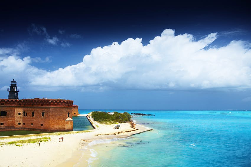 The edge of Fort Jefferson against blue skies and blue waters