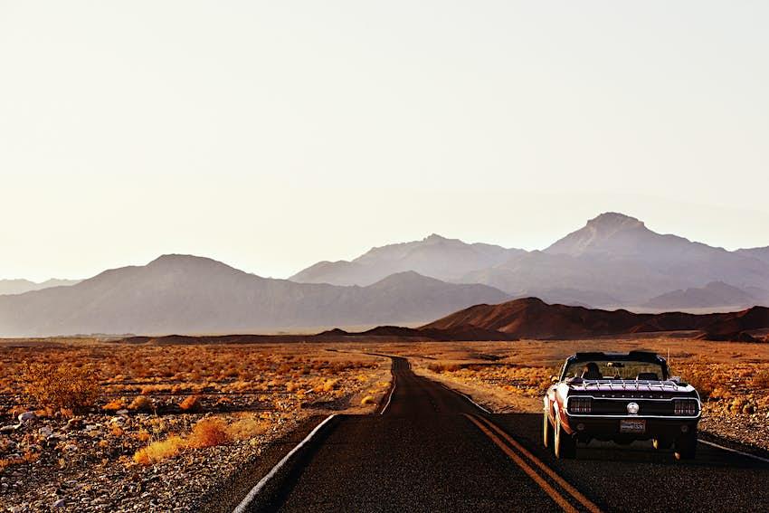 Ford Mustang on desert highway.