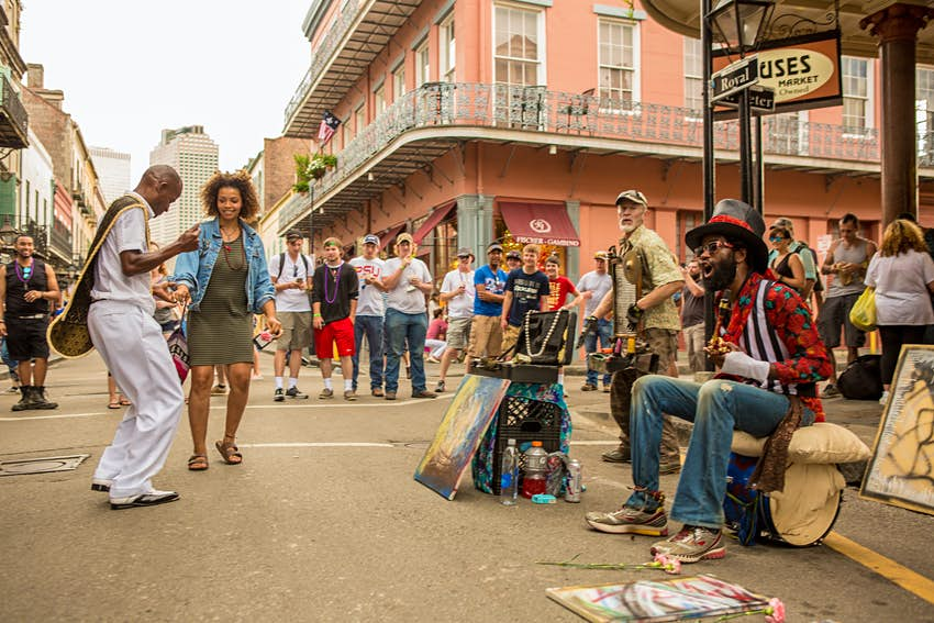 People dancing to music on a street corner in the French Quarter in New Orleans, Louisiana