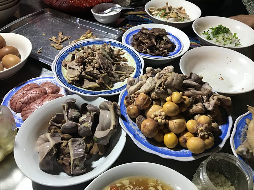 Brains and organs are among the dishes laid out on a soup street food stall
