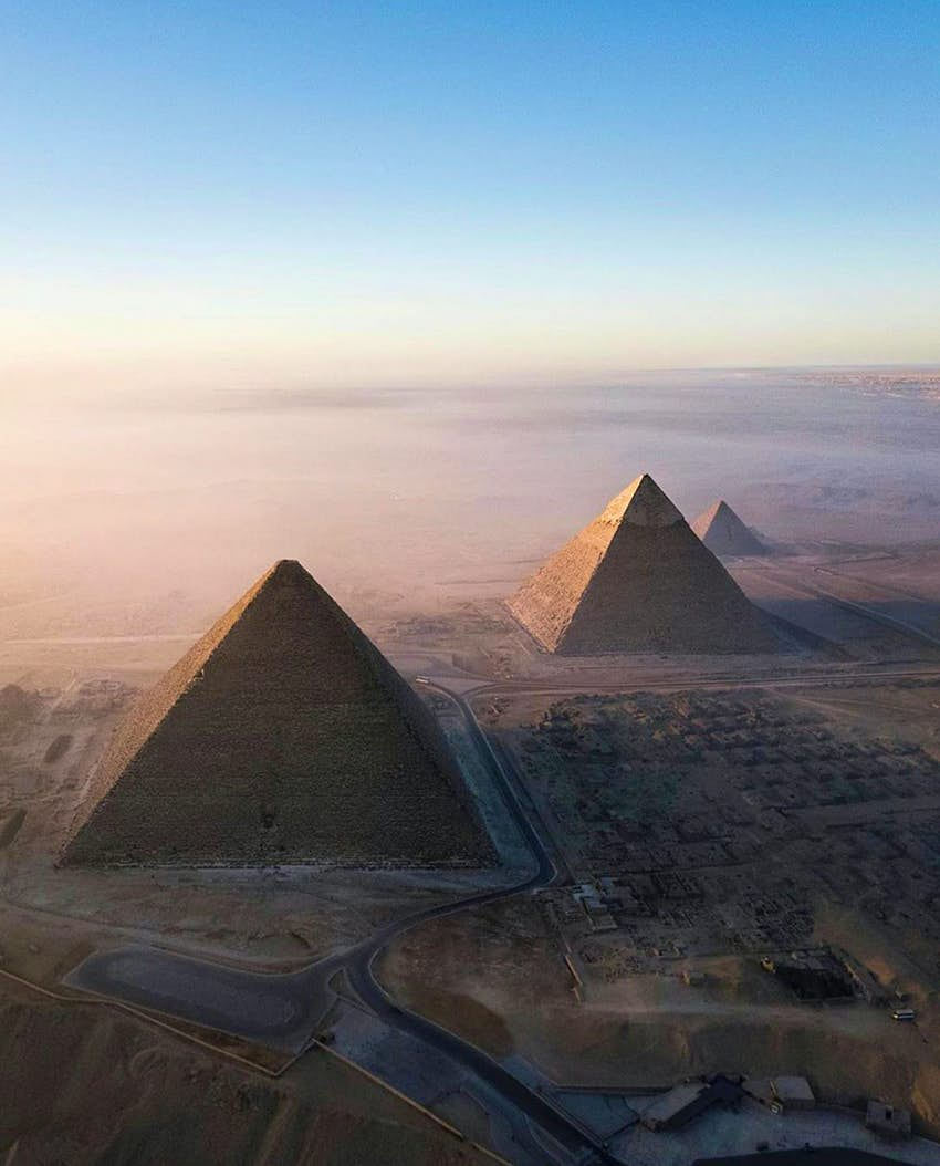 Aerial view of the pyramids of Giza in the desert by day