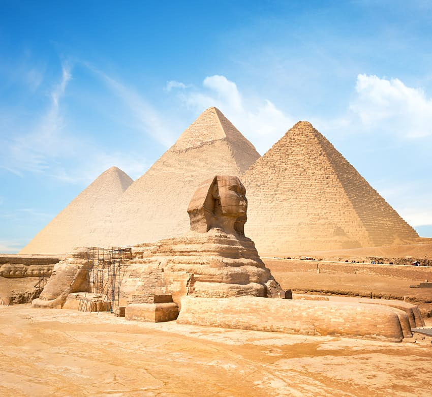 Great Sphinx of Giza and the Pyramids in the background on a clear sunny day