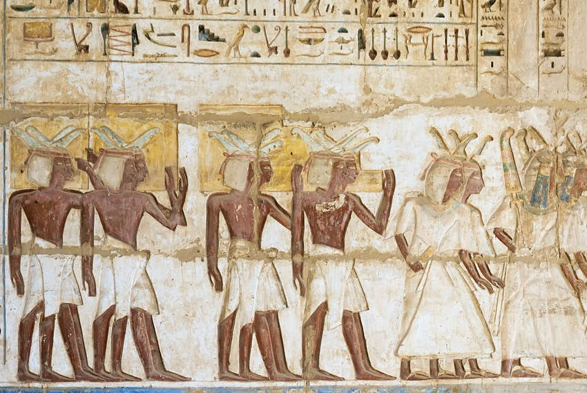 Hieroglyph color of a religious service in the temple at medinet habu in Luxor Egypt