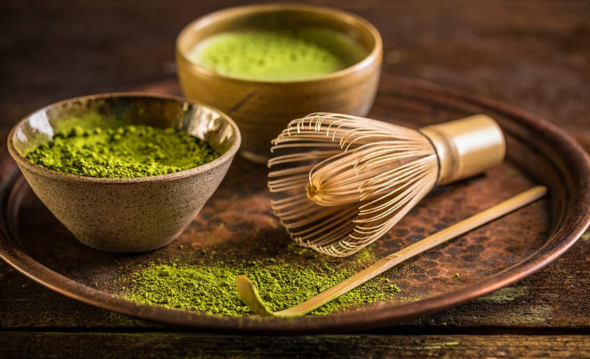 Plate of powdered green matcha and matcha tea
