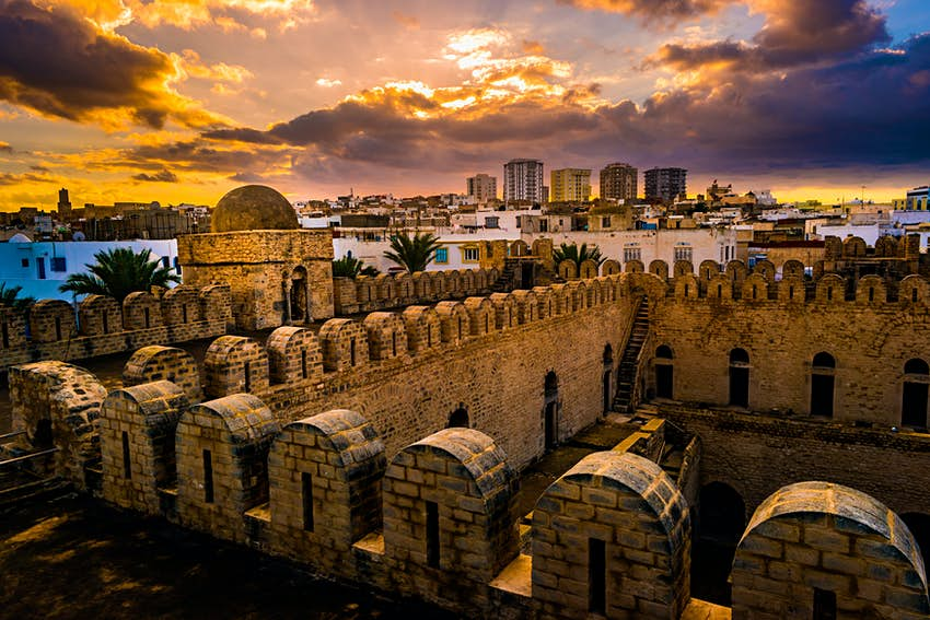 The fortress walls of the Ribat of Sousse during sunset.