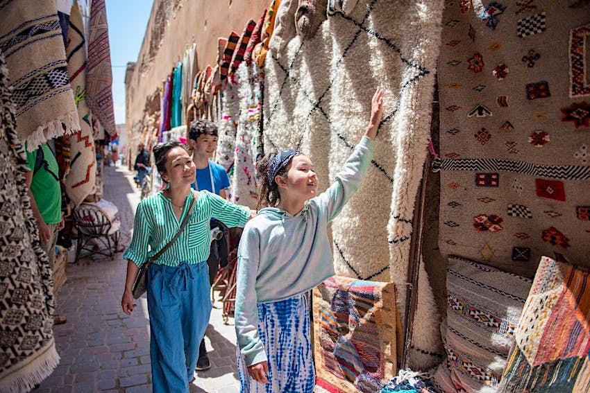 Women looking at Berber rugs in Marrakech