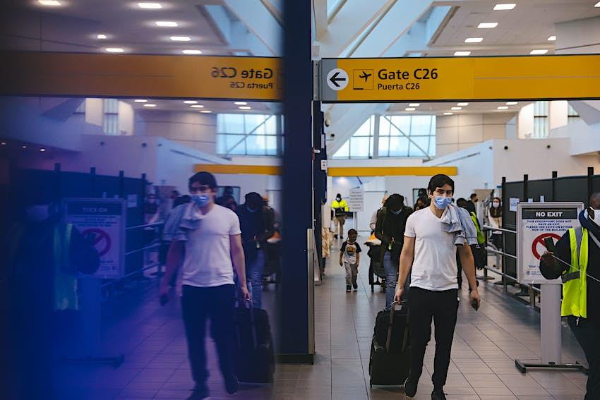 Travelers in masks at La Guardia airport