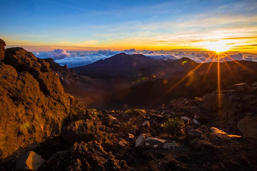 A sunset behind volcanic mountains at Haleakalā National Park, Hawaii