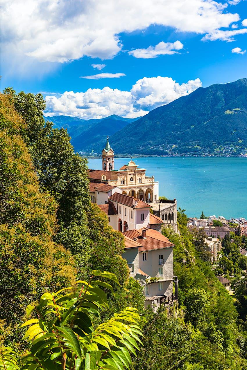 View of Madonna del Sasso Church above Locarno city and the Maggiore lake on a summer day in Ticino, Switzerland