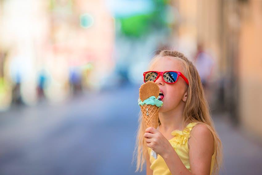 A girl eats gelato in Rome