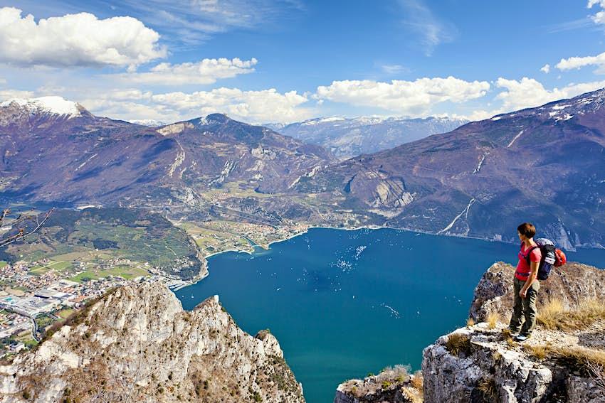 Climber on the Cima Rocca, via ferrata with view of Lake Garda, Riva and Nago-Torbole, Trentino, Italy, Europe