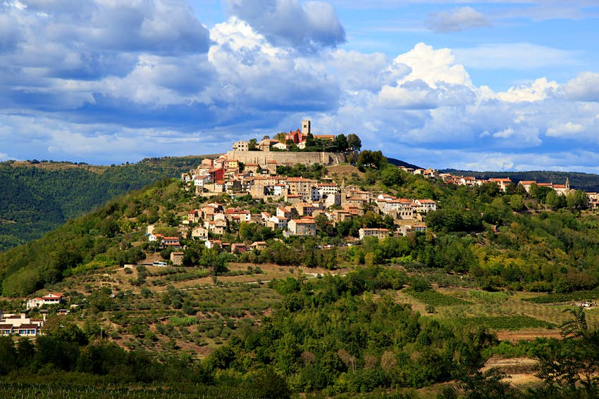 A hilltop village surrounded by vineyards