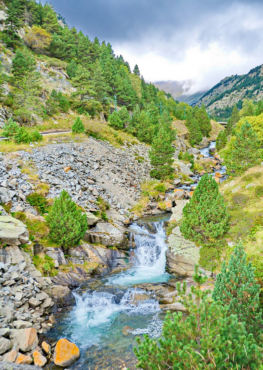 Cascade waterfalls in the valley of Vall de Nuria in the Pyrenees Mountains in Catalonia, Spain