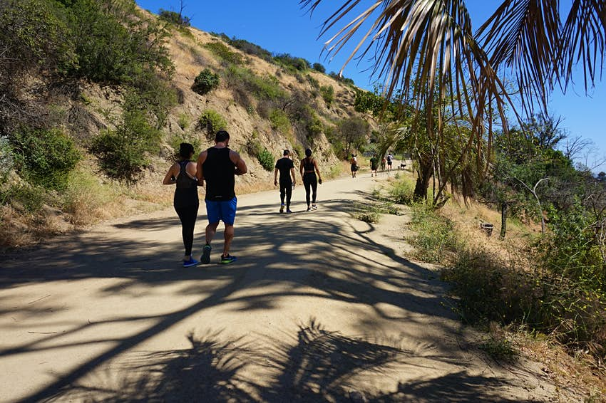 People walk along a hiking trail at Runyon Canyon Park in the Hollywood Hills