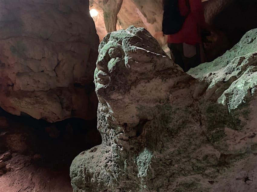 Closeup of a sculpture of a woman's face inside Hamilton's Cave, Long Island