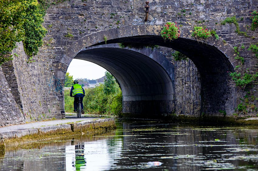 A cyclist going under Harbour Mullen Bridge along the Royal Canal Greenway