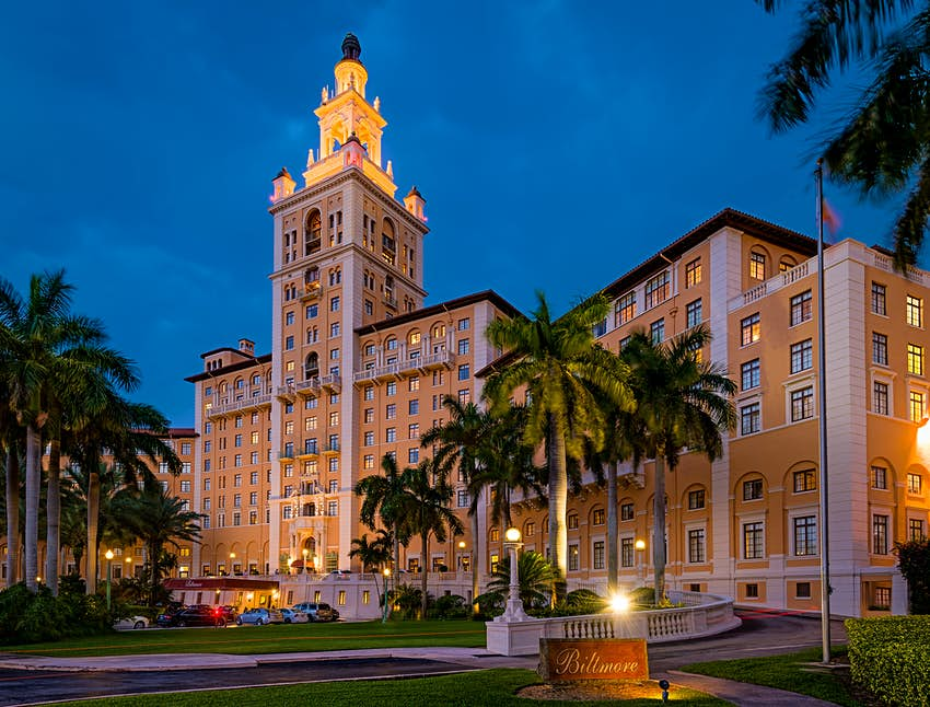 A nighttime photo of the exterior of the Biltmore Hotel