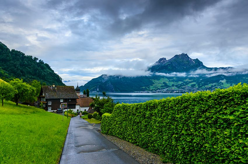 An idyllic green landscape at village Kehrsiten on the banks of Lake Lucerne
