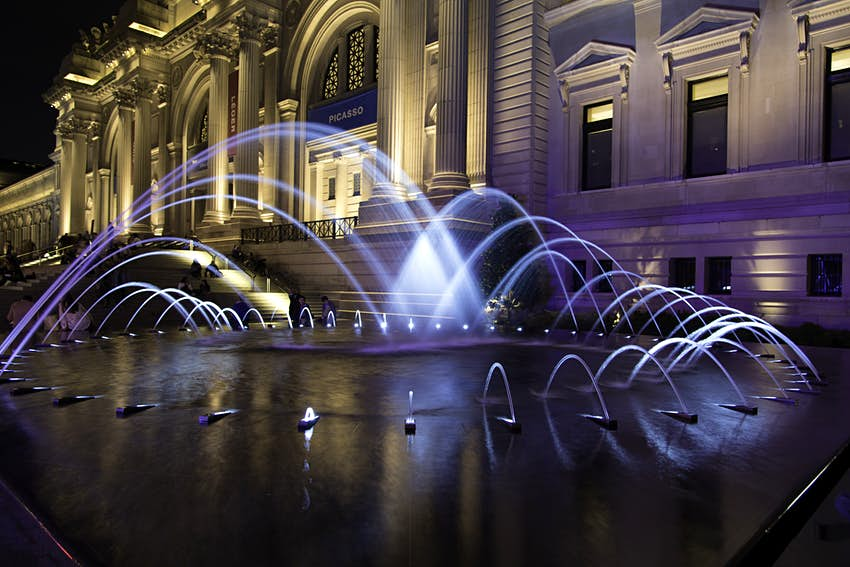 Illuminated fountain at entrance to Metropolitan Museum of Art, New York City, New York State, USA