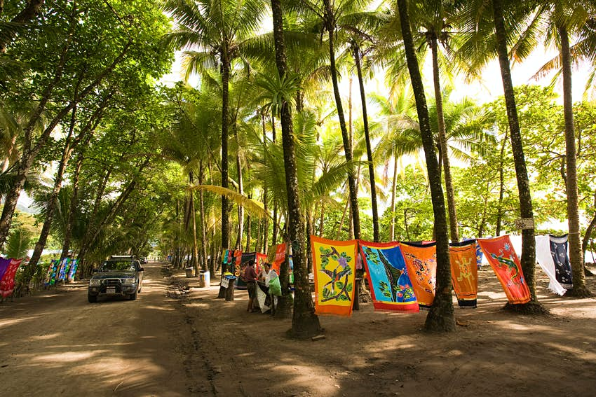 Costa Rica Dominical seafront market selling souvenirs and beach textiles