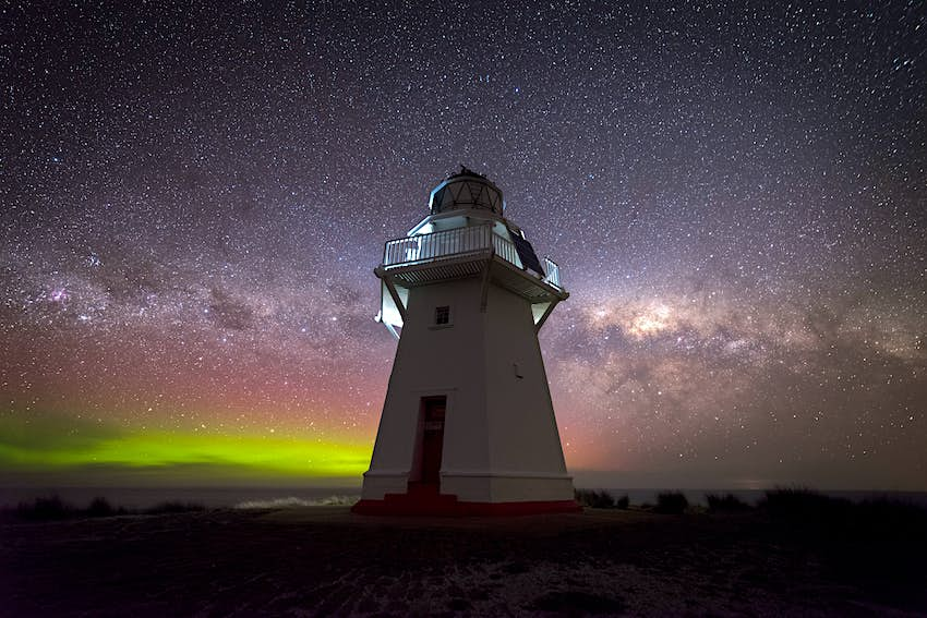 Milkyway setting behind Waipapa point lighthouse in the Catlins New Zealand