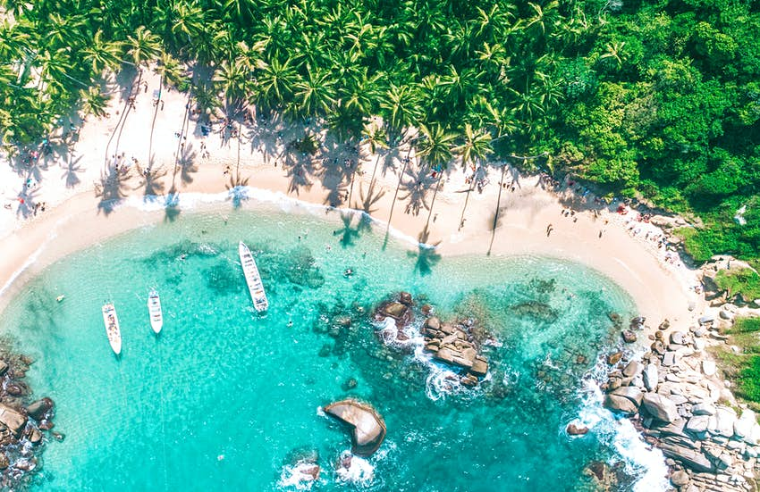 An aerial shot of a white sandy beach