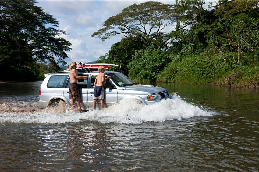 Driving through the river Bongo on the west coast of Costa Rica