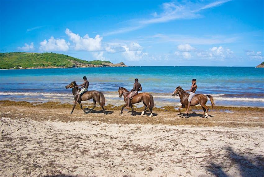 horseback riding trio on Cas En Bas beach ; beautiful afternoon