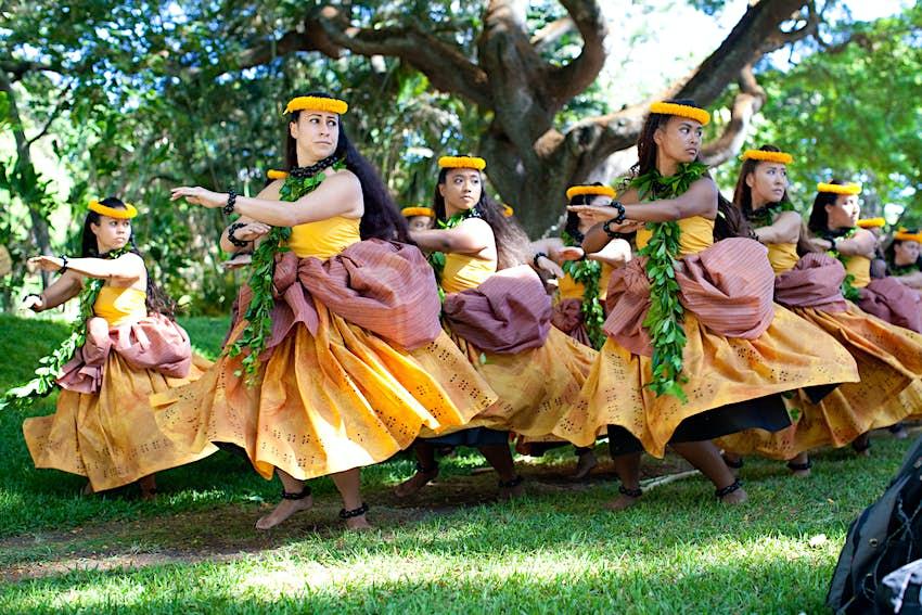 The Halau Na Mamo O Puuanahulu dance troupe performs at the Honolulu Hula Festival, summer of 2013 Honolulu Hawaii.